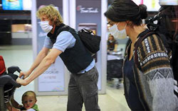 Passengers using protection mask in the airport - traveling tips