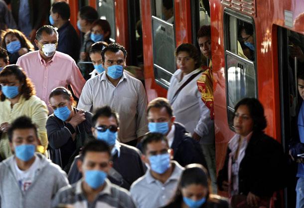 Passengers wearing masks in a railway station against swine flu