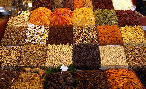 Stalls With Tasty Sweets and Nuts Sold at La Mercat de la Boqueria, Barcelona
